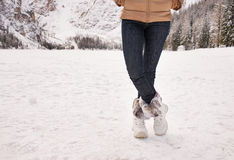 Closeup on legs of woman outdoors among snow-capped mountains Royalty Free Stock Images