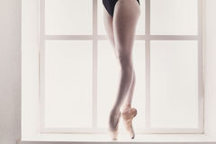 Closeup legs of young ballerina in pointe shoes, ballet practice stock photos