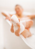 Closeup on legs of young woman in bathtub Stock Photo