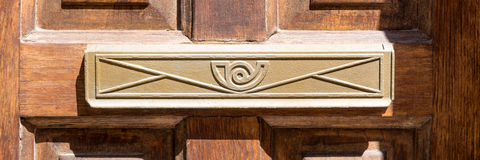 Closeup of letter box in wooden door Stock Photography