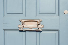 Closeup of letter box in a wooden door Royalty Free Stock Image
