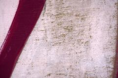 Closeup light beige texture walls.with a red stripe Royalty Free Stock Image