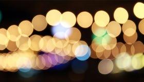 Closeup light bokeh background. Orange bokeh background from night restaurant Stock Image