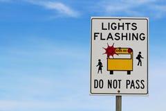 Closeup of a Light Flashing Do Not Pass Sign.  Royalty Free Stock Photo