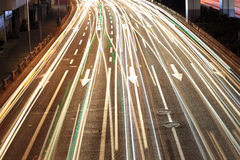 Closeup of the light trails on road Stock Photos