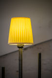 Closeup with lighted yellow lamp. Vertical view with yellow ligh Stock Photos