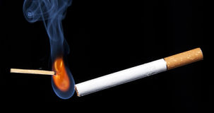 Closeup lighting cigarette Stock Images