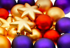 Closeup of lila, red and golden baubles Royalty Free Stock Photography