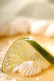 Closeup of lime resting on a key lime pie Stock Images
