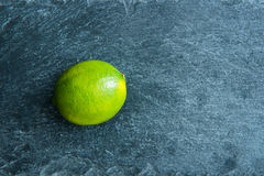 Closeup on lime on stone substrate Royalty Free Stock Photos