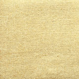 Closeup of linen texture covered with gold paint Royalty Free Stock Images