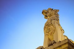 The lion statue is located on the head of the temple. stock images