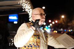 Closeup, Lions Club emcee announcing holiday parade Royalty Free Stock Photography