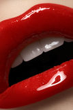 Closeup lips with fashion glossy red make-up stock photos