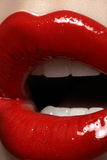 Closeup lips with fashion glossy red make-up royalty free stock photography