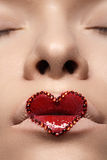 Closeup lips with red heart make-up & rhinestones. Valentines Day style Royalty Free Stock Images