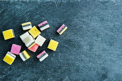 Closeup on liquorice candies on stone substrate Royalty Free Stock Photos