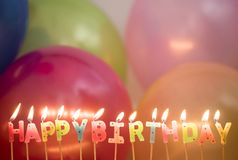 Closeup of lit birthday candles birthday wishes concept Stock Images