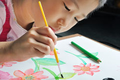 Closeup little asian girl hand paint watercolor picture Stock Image