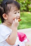 Closeup little asian (thai) girl enjoy eating her lunch Stock Image
