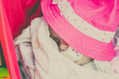 Closeup of little baby covered with pink hat. Stock Images