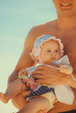 Closeup of little baby in parent hands. Royalty Free Stock Images