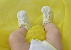 Closeup of little baby s footstep with shoes. Closeup of little baby s footstep with white shoes Royalty Free Stock Photos