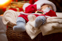 Closeup of little baby Santa feet in blue wool socks Stock Image