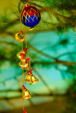 Closeup of little bells Christmas tree ornament. Royalty Free Stock Images