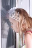 Closeup of little blond girl with white bandage looking out Royalty Free Stock Photos