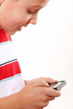 Closeup child plays games on the mobile phone Stock Images