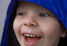 Closeup of Little Boy's Face Looking Sideways. Closeup of a little boy's face while laughing and looking with his eyes sideways.  Blue hazel eye color, Caucasian Stock Photography