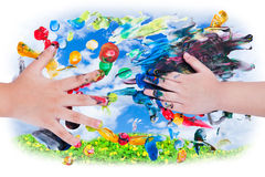 Closeup of little children hands doing finger painting with vari Royalty Free Stock Photos