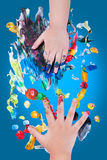 Closeup of little children hands doing finger painting Stock Photo