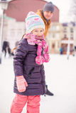 Closeup of little girl enjoys skating with her Royalty Free Stock Photos