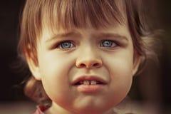 Closeup little girl face Stock Photos