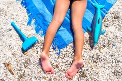 Closeup of little girl legs on tropical beach with Royalty Free Stock Image