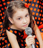 Closeup little girl with microphone Royalty Free Stock Photos
