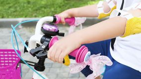 A little girl on a bicycle stock footage