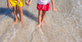 Closeup of little girls legs on tropical beach Stock Images