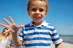 Closeup of a Little Kid Enjoying Outdoors Stock Photo