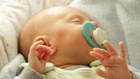Little newborn baby girl sleeping. Full HD motorized slider. 1080p. Closeup little newborn baby girl 24 days sleeping with dummy in mouth. Full HD with motorized stock footage