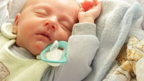 Little newborn baby girl sleeping. Full HD motorized slider. 1080p. Closeup little newborn baby girl 24 days sleeping with dummy in mouth. Full HD with motorized stock video footage
