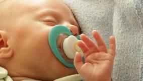 Closeup little newborn baby girl sleeping with dummy in mouth. Full HD. Closeup little newborn baby girl 24 days sleeping. Full HD 1920X1080P stock footage