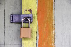 Closeup of lock on colorful old door stock photography