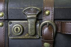 Closeup of lock and leather strap on vintage suitcase, travel co Stock Photography