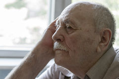 Closeup of a lonely senior man Royalty Free Stock Image