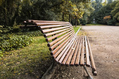 Closeup lonely wooden bench in the park Stock Image
