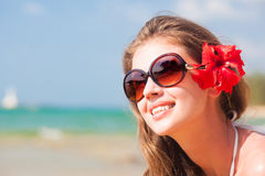 Closeup long haired woman in bikini with flower in Royalty Free Stock Image