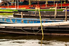 Closeup of long tailed boat mooring on the shore. royalty free stock photography